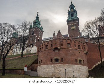 The main entrance gate of Wawel Royal Castle, with Tadeusz Kościuszko Monument in front of it, located in Krakow historical city center. Krakow, Poland.