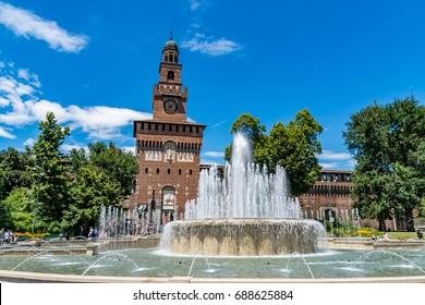 Main entrance to the Sforza Castle - Castello Sforzesco and fountain in front of it, Milan, Italy