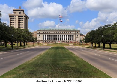 The main entrance to Texas A & M University with the Jack K. Williams Systems Administration building at the end of road in College Station, Texas