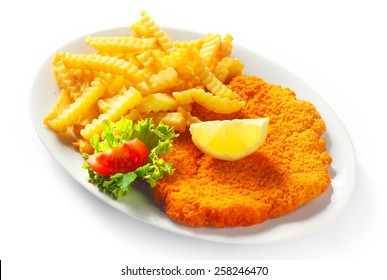 Main Entree Concept - Close up Gourmet Crumbled Schnitzel with French Fries on White Plate. Isolated on White Background.