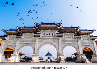 The main gate of National Taiwan Democracy Memorial Hall ( National Chiang Kai-shek Memorial Hall ), Taipei, Taiwan with the national theater, music hall, and Chiang Kai-Shek Memorial Hall at back