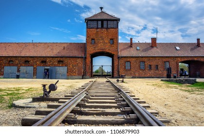 Main gate to nazi concentration camp of Auschwitz Birkenau with train rail, Poland on April 14, 2018. Here were exterminated 1.5 million people at the second world war.