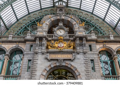 Main hall with clock and plate with Dutch city name 'Antwerpen' of famous art deco station of Antwerp, Belgium