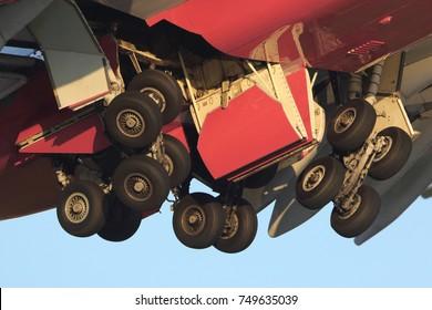Main landing gear of civil airplane retracting.