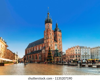 Main Market square in Krakow with St. Mary's Basilica before Christmas, Poland