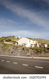 main mountain road in spain with a house build right next to the road