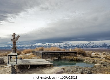 The main pool at Spencer Hot Springs is fed by an 165 F source pool. An adjustable valve allows temperature control while you take in the great view of the Toiyabe Range, Lander County, Nevada, USA.