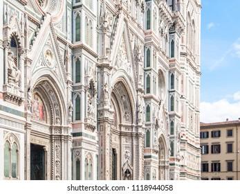 Main portal of Florence Catherdal, Cattedrale di Santa Maria del Fiore or Il Duomo di Firenze, with ornamental mosaic, Firenze, Tuscany, Italy.