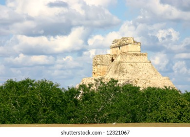 Main pyramid on mayan sute Uxmal over blue sky