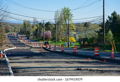 A main road in Twinsburg, Ohio, is shown in the final stages of constructions, which included widening, new pavement, and adding a roundabout.