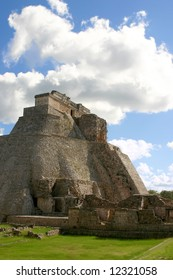 Main round pyramid on mayan site over sky