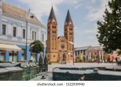 Main square with church in Hungarian city, Nyíregyháza, mini sculpture in front