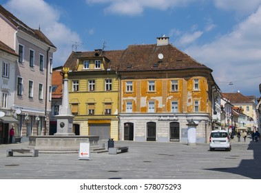 Main square in medieval town of Kranj, Slovenia with colorful buildings at sunny summer day