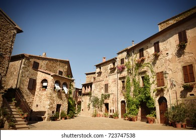 Main square of the medieval village Montemerano in summer. Tuscany, Italy
