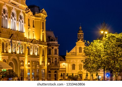Pécs main square (Széchenyi Square) at night with the Town Hall and Saint Sebastian's church
