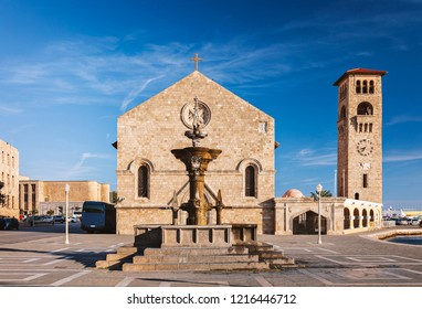 The main square in Rhodes town harbour, with the grand fountain and Evagelismos church.