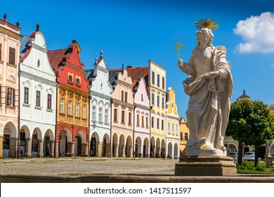 Main square of Telc city, a UNESCO World Heritage Site, on a sunny day with blue sky and clouds, South Moravia, Czech Republic.
