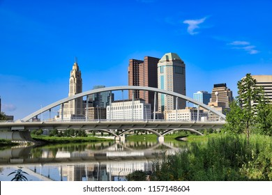 The Main Street Bridge is a major landmark in downtown Columbus, Ohio.  The Scioto Mile park adds green space to this skyline.