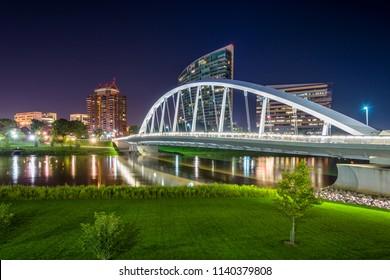 The Main Street Bridge and Scioto River at night, in Columbus, Ohio.