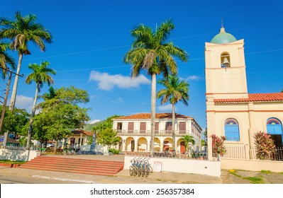 The main street of the Cuban town with a beautiful church in the background, Vinales, Cuba