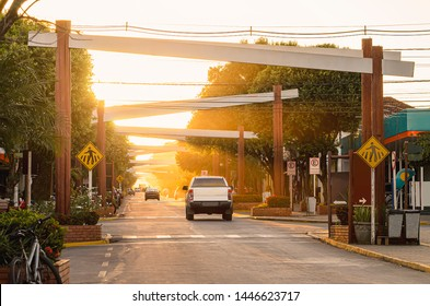 Main street of the downtown of Bonito MS, Brazil. Coronel Pilad Rebua street. Avenue decorated with portals and plants at the sunset. Touristic destination of Bonito city.