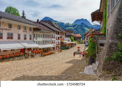 Main street in Gruyere village in Fribourg canton by beautiful day, Switzerland