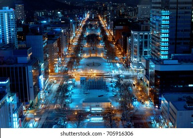 The main street & landmark park of Sapporo city are decorated by illumination in winter from observation deck of TV tower, Hokkaido, Japan