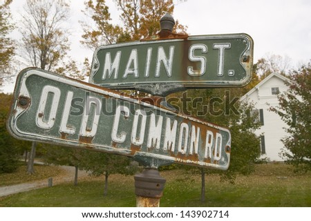 Main Street and Old Common Road sign in autumn, western Massachusetts, New England