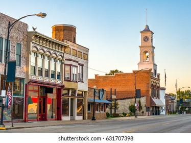 Main street of quaint USA small town in midwest America with storefronts and  clock tower