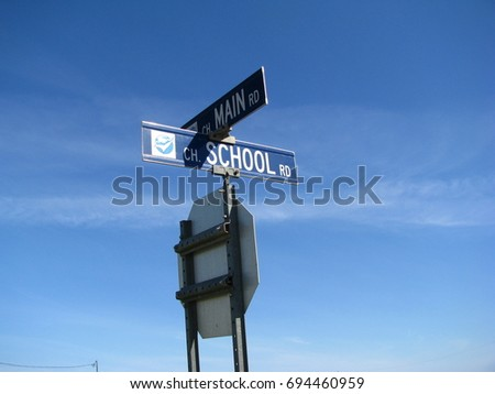 114d85a776903 Main street and School street blue signals at crossing and clear blue sky on  isle d'Entree, Magdalene island, Isles de la Madeleine, Quebec, Canada -  Image