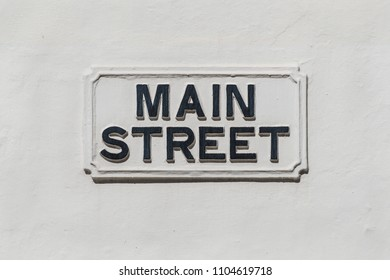 Main Street sign on a white wall in the British overseas territory of Gibraltar