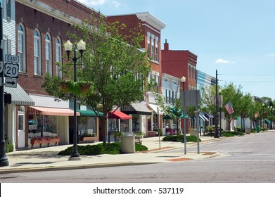 A main street in a typical Midwest small town, complete with U.S. flags.