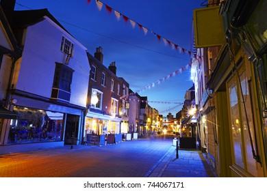 Main thoroughfare of Canterbury, Kent illuminated at dusk