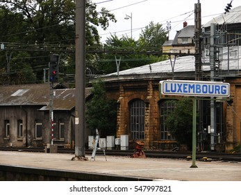 Main train station in Luxembourg city with city name board reading LUXEMBOURG