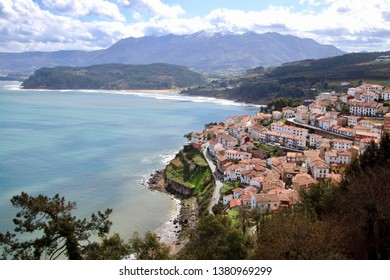 Main view of Lastres village, on of the most beautiful spots in Asturias region, where the snowed Pico de Europa mountains, die close to the sea, Asturias, Spain.