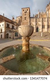 Main view of the Royal Monastery of Guadalupe with the fountain of the square in the foreground, Caceres, Extremadura, Spain