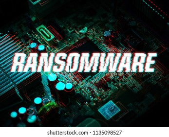 Mainboard Computer with Glitch text effect written RANSOMWARE