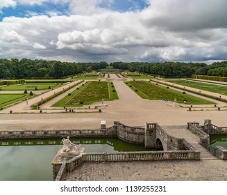 MAINCY, FRANCE - June 17, 2018: View of the gardens from the steps of the castle Château le Vaux-le-Vicomte which  is a baroque French Château located in Maincy, France