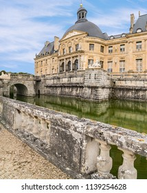 MAINCY, FRANCE - June 17, 2018:View of the Château le Vaux-le-Vicomte castle and surrounding moat. It is a baroque French Château located in Maincy, France