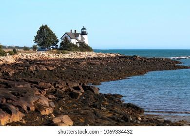 Maine lighthouse with summer sun