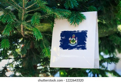 22348a2c0abd Maine state flag printed on a Christmas shopping bag. Close up of a  shopping bag
