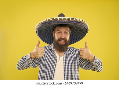 Maintain tradition. Mexican guy festive outfit ready to celebrate. Man bearded cheerful guy wear sombrero mexican hat yellow background. Mexican party concept. Celebrate traditional mexican holiday.