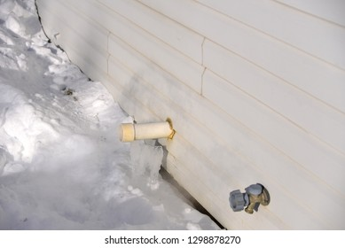 Maintained furnace vent with snow removed to keep vent from becoming blocked during cold Wisconsin cold snap in January next to water spigot.