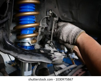 maintaining a car shock absorbers at garage.
