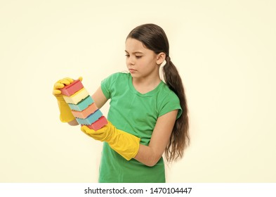 Maintaining the order in the house. Pretty kitchen maid. Household duties. Small housekeeper holding dish sponges in rubber gloves. Little housemaid ready for household help. Cleaning and washing up.