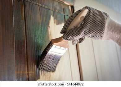 Maintaining of wooden surfaces with fresh protective paint.