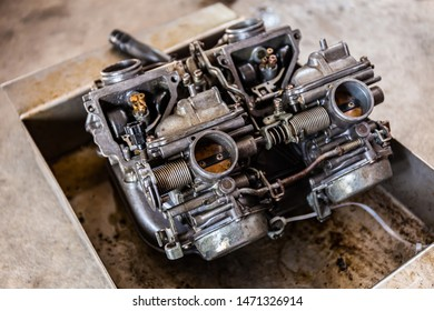Maintenance and clean the carburetor parts for the fire pump old motorcycle engine. Close up and select focus