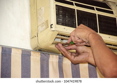 Maintenance and cleaning  old air conditioner.