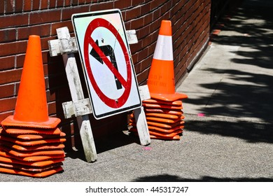 Maintenance cones on side walk