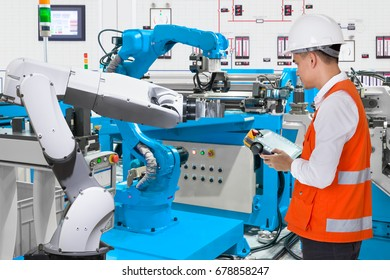 Maintenance engineer programing automated robotic industry 4.0 concept